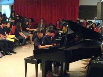 Two young maestros playing piano at our Kuala Belait recital