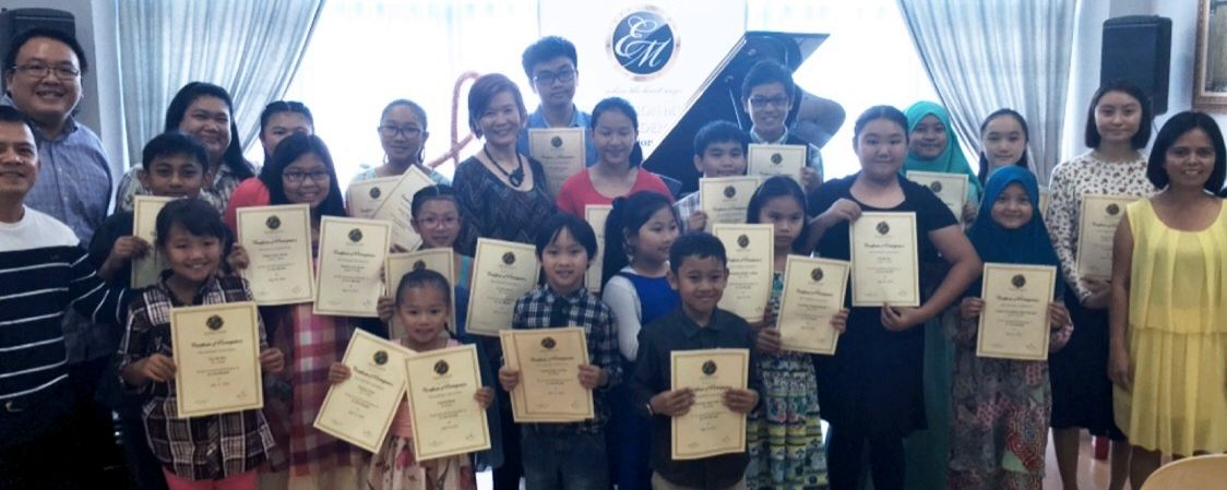 Young Music students posing with their certificates