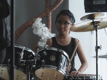 A young musician plays the drums at our Kuala Belait recital