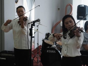 Violin Musicians playing for our Kuala Belait recital